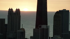 Aerial sunrise silhouette of John Hancock building Chicago Illinois US Stock Footage