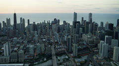 Aerial view at sunrise of Downtown city buildings in Chicago America Stock Footage