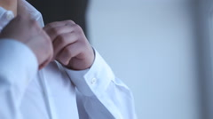 Silhouette of a businessman wears a shirt front of the window Stock Footage
