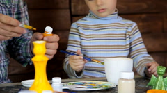 Father and son by painting pottery Stock Footage