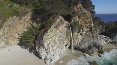 4K aerial drone shot of beautiful Mcway Falls in Big Sur, CA Stock Footage