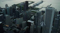 Aerial sunrise view of Navy Pier and city skyscrapers Chicago USA Stock Footage
