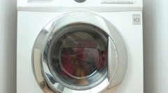 New washing machine washes coloreds laundry Stock Footage