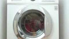 New washing machine washes coloreds laundry - stock footage