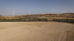 Aerial view of wind farms on hills Stock Footage