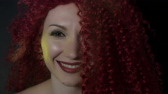 4k shoot of a redhead girl in studio with yellow dust on her face - stock footage
