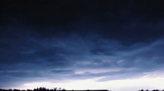Slow motion video clip of night sky with lightning and stormy clouds. Stock Footage