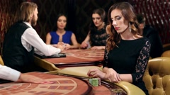 Woman Takes the Card and Makes a Bet in a Casino Stock Footage