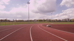 4K Action tracking shot going around outdoor running track. No people. Stock Footage