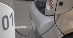 Electric car charging at power supply station - stock footage
