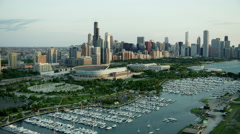 Aerial view at sunrise of Soldier Field football stadium Chicago USA Stock Footage