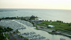 Aerial sunrise view of boats on Lake Michigan and marina in Chicago USA Stock Footage