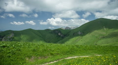 Mountain under the blue sky with clouds. Caucasus, Russia Stock Footage