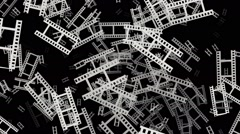 Flying film tape fragments in white on black Stock Footage