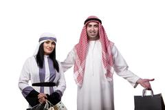 Happy arabic family after shopping isolated on white - stock photo