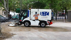Road sweeper street cleaning machine performs maintenance in France Stock Footage