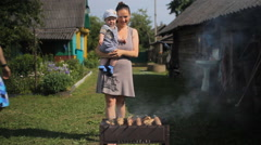 The kid's father and mother cook meat on the fire. Barbecue is almost ready Stock Footage