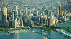 Aerial sunrise view of Chicago waterfront and modern skyscrapers - stock footage