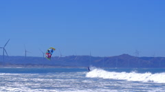 Fun of extreme sport. Kite boarding in ocean along sea coast at sunny summer day Stock Footage
