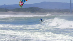 Extreme summer sports background. Kitesurfing along sea coast Stock Footage