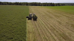 AERIAL VIEW. Combine Harvester Cutting Field - stock footage