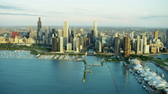 Aerial distant view of Chicago USA cityscape and marina Stock Footage