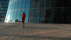 Businesswoman in red suit using smart phone Stock Footage
