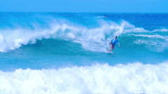Professional sportsman kitesurfer rides kite board through rough sea waves Stock Footage