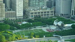Aerial sunrise view of Aon Center Millennium Park downtown Chicago USA Stock Footage