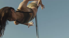 Fit attractive girl dancing near portable pole at summer day over the skyline Stock Footage