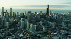 Aerial sunrise view of modern skyscraper buildings and Lake Michigan Chicago Stock Footage