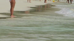 Tourists walk on the beach Stock Footage