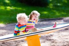 Kids having fun on a playground - stock photo