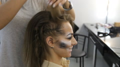 Fashion model girl in Hairdressers. hairdresser's hand work on client's hair Stock Footage