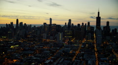 Aerial illuminated view of skyscrapers in Chicago Illinois at sunrise Stock Footage
