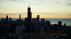 Aerial sunrise silhouette of Willis Tower and Chicago city skyline USA Stock Footage