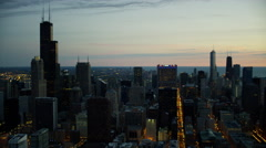 Aerial illuminated view of city of Chicago Illinois at sunrise Stock Footage