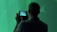 Man Filming Sea Life At Aquarium - stock footage