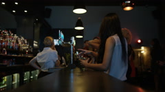4K Fun bar staff serving drinks to party crowd in nightclub Stock Footage