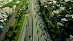 Aerial overhead view of Chicago freeway traffic USA Stock Footage