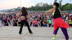 People perform Zumba dance Stock Footage