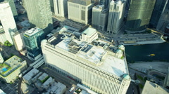 Aerial overhead view of Chicago city buildings and water traffic Stock Footage