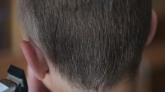 Boy haircut short hair - stock footage
