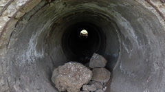 Dolly shot of an abandoned dirty water tunnel Stock Footage