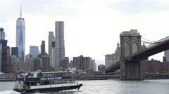 East River Ferry of New York City departing towards Brooklyn Bridge 4k Stock Footage