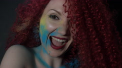 4k shoot of a redhead girl in studio smiling and shaking hairs - stock footage