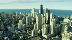 Aerial view of Lake Michigan behind Chicago city skyscraper buildings Stock Footage