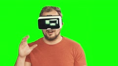 Young man wearing virtual reality VR glasses / googles. Stock Footage