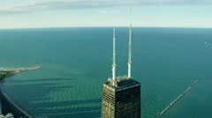 Aerial view in close up of Hancock Building and Lake Michigan Chicago Stock Footage