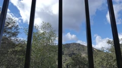 Topanga Canyon Mountain timelapse through a  Fence Stock Footage